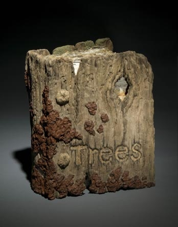 The Book of Trees by artist Eric Serritella, whose ceramic trompe l'oeil sculptures are formed from clay to mimic weathered logs & birch trees. The cover of this book is depicted as weathered natural wood signifying how tree products have held the printed word of humans for centuries. The aged cover symbolizes how the printing medium is aging slowly toward a possible death. The interior is filled with pages made from the bark of the most paper-like of trees, the birch.