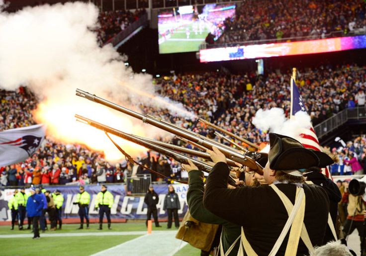 Re-enactment enthusiasts fire their guns as the New England Patriots play the Indianapolis Colts in the first quarter of their AFC Championship game at Gillette Stadium in Foxborough, Massachusetts