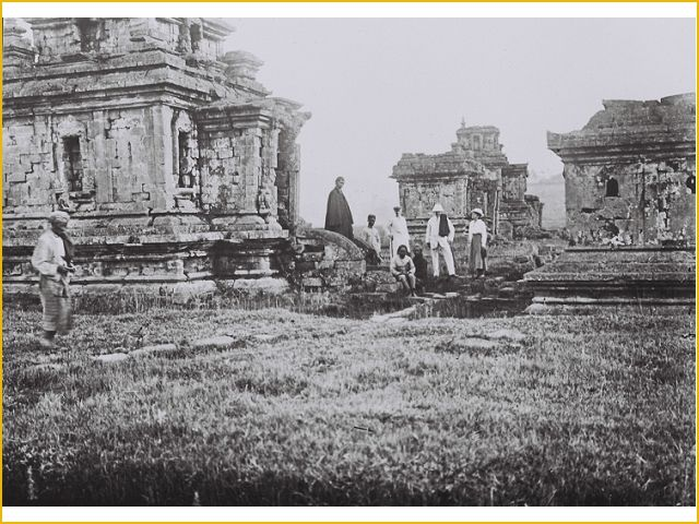 Some Dutch tourists being photographed in front of Arjuna Temple, Dieng, Jawa Tengah  in about 1921.