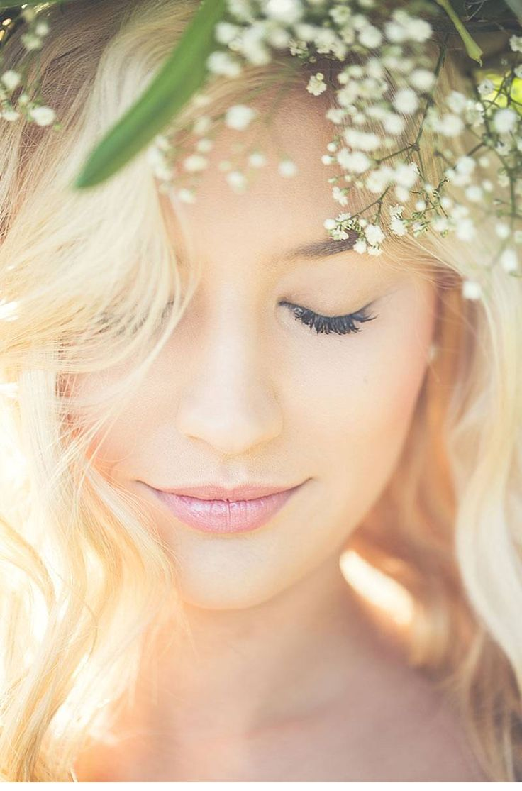 beautiful bride with a dreamlike flower crown and natural makeup