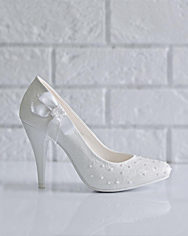 Свадебные туфли: C751-G360 - http://vbelom.ru/catalog/svadebnye-tufli-c751-g360/ Потрясающие свадебные туфли на высоком каблуке.  Туфли декорированы не только цветочным тиснением, но и роскошным атласным бантом. Заостренный мыс дополняет шикарный высокий каблук. В этих туфельках Вы будет�