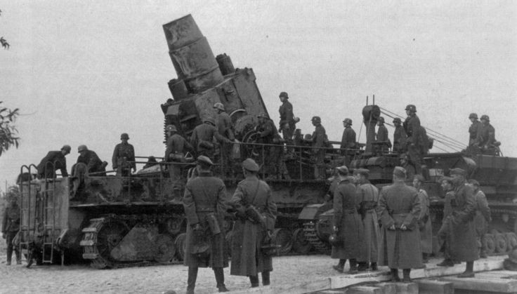"""The only significant action during Operation Barbarossa for the 60 cm Karl-Gerät self-propelled siege mortar was the bombardment of the Soviet fortress of Brest-Litovsk, where a battery of two howitzers from 833rd Heavy Mortar Battery fired a total of 31 rounds against the enemy. Here the 60 cm Karl-Gerät """"Odin"""" is prepared to fire on the fortress in June 1941.."""