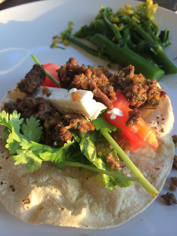 Picadillo taco, goat cheese, cilantro, tomato and broccolini