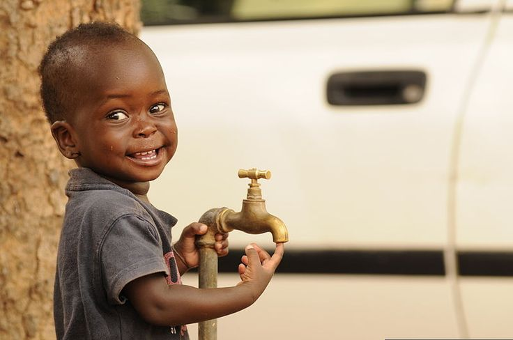 A child waits outside a medical clinic as part of Western Accord 2012 in Thies, Senegal, June 10, 2012.