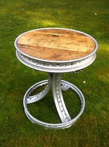 Stunning one-off hand-made contemporary table made with motorcycle wheels.  Available from www.cushtynretro.co.uk