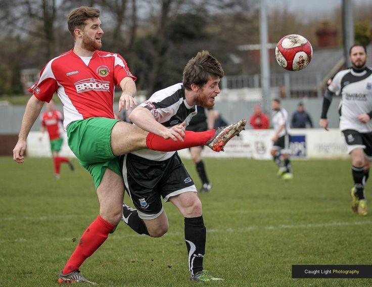 Tom Owen crosses the ball under pressure from the Bamber Bridge defender