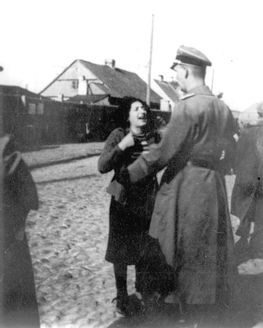 Plonsk, Poland, a Jewish woman pleading before an SS officer during a deportation. Sad to say it will not help her. Some SS would listen and then shot the Jewish person just to rid of them. Monsters