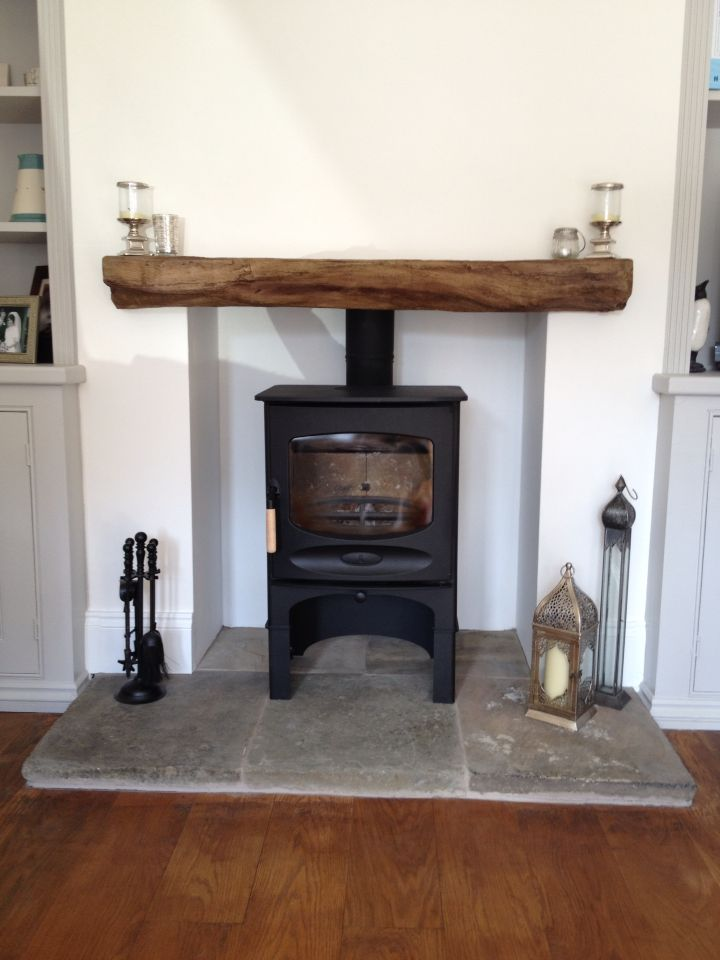 Timber effect cement fireplace beam. Charnwood log burner. Reclaimed York stone hearth.