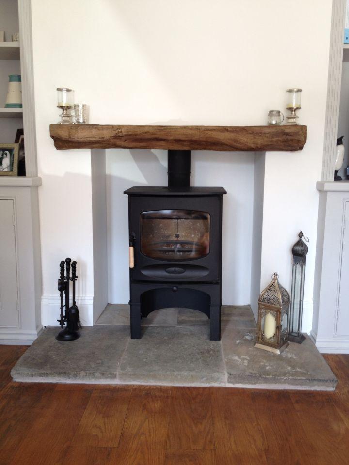 Timber effect cement fireplace beam. Charnwood log burner. Reclaimed York stone hearth.