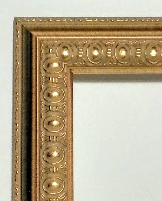 Check out this item in my Etsy shop https://www.etsy.com/listing/463176754/ornate-gold-picture-frame-oval-bead