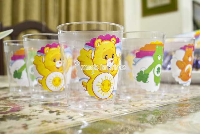 Disposable glasses decorated with Care Bears stickers