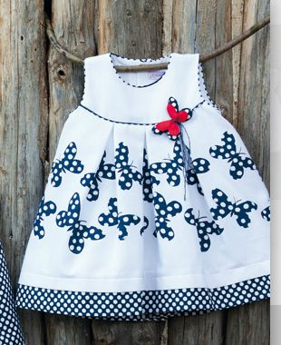 Pique dress with appliqued butterflies