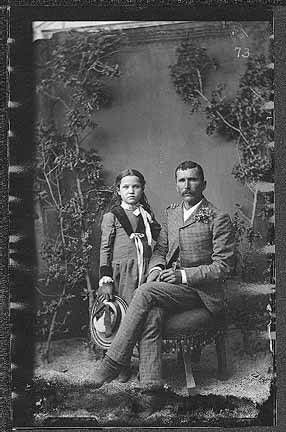 B.T. Powell and daughter, mining area of Hillsboro and Kingston, New Mexico. Photo by J.C. Burge, ca. 1885-1892. Palace of the Governors Photo Archives 076839.