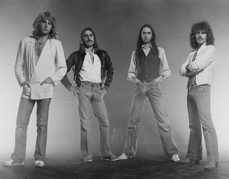 British rock band Status Quo - guitarist Rick Parfitt, bassist Alan Lancaster, singer and guitarist Francis Rossi, and drummer John Coghlan pose for a group studio portrait in 1979