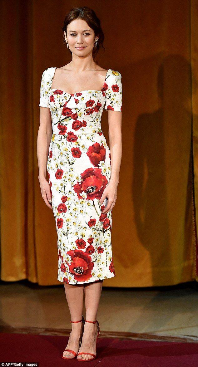 Flower power: Olga Kurylenko stepped out in style alongside Jeremy Irons during the photo .