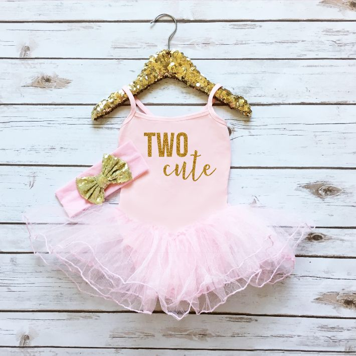 Let your little girl sparkle in style on her birthday in this adorable sparkly tutu dress. Printed with TWO Cute in sparkly glitter gold. - Spaghetti Strap Leotard with attached tutu - Made of 95% Cot