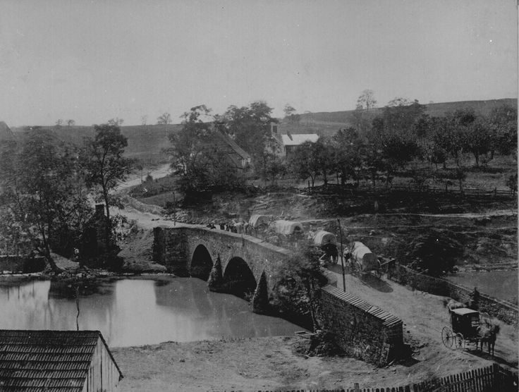 Soldiers and wagons crossing Burnside's Bridge that traverses Antietam Creek near Sharpsburg, Maryland, site of heavy combat during the Battle of Antietam (Sharpsburg) on September 17, 1862. Photographed by Alexander Gardner.