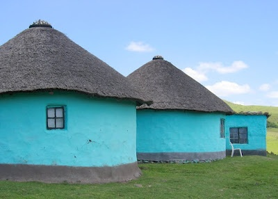 Color is a great way to enliven...huts??? (near Coffee Bay, South Africa) (photograph by Andrew Schapiro)