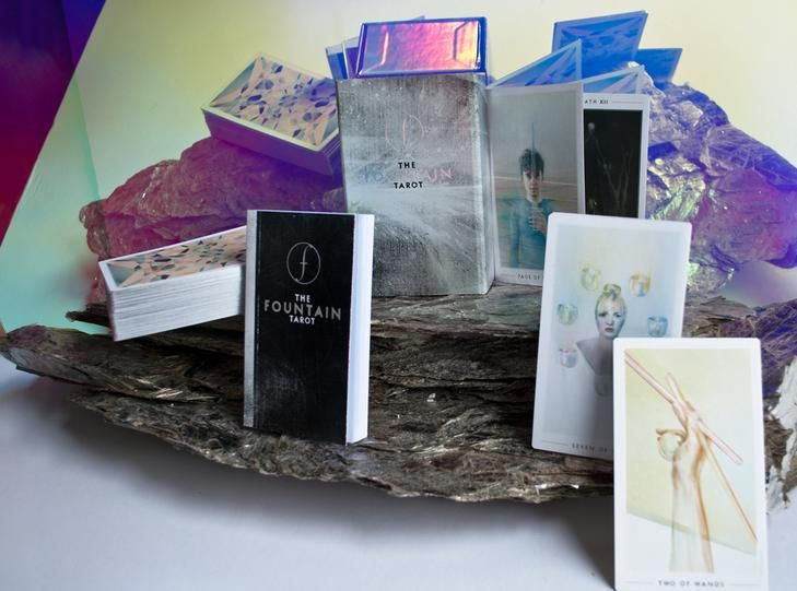 The Fountain Tarot UK stockist. A stunning fine-art tarot deck, illustrated with sacred geometry and flashing silver edges created by Jonathan Saiz.