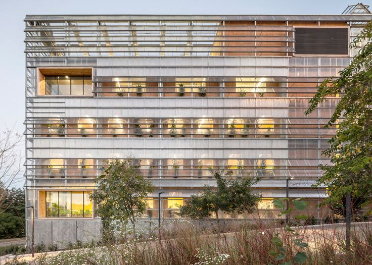 Palaeontology research centre wrapped in computer-controlled shutters.