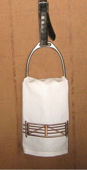 Leather strap and stirrup iron as a towel holder. Easy idea and looks great