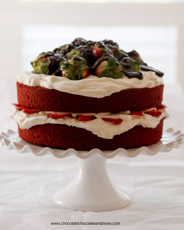 Red Velvet Strawberry Shortcake-A moist crumbed cake, layered with fresh whipped cream, strawberries and chocolate ganache!
