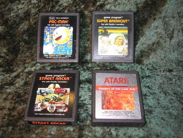 4 Atari 2600 Games Raiders of The Lost Ark Street Racer Super Breakout Pac-Man