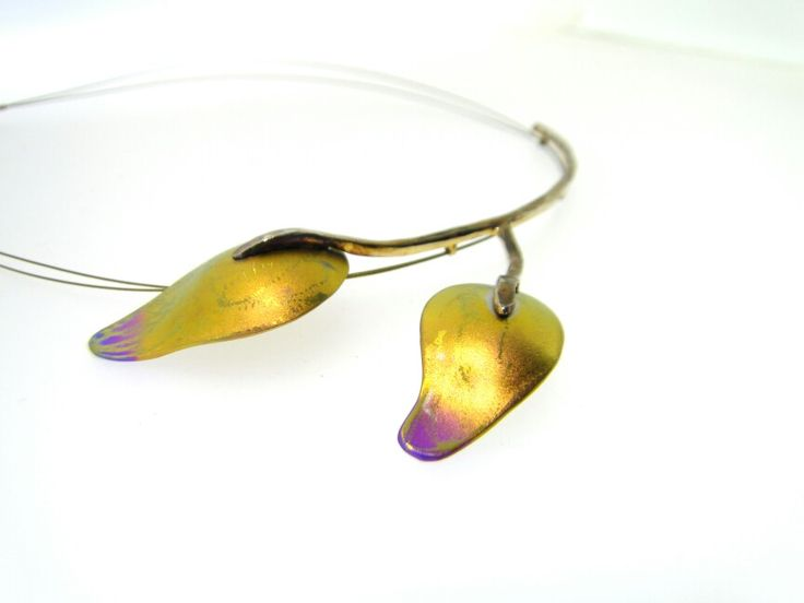 Two autumn leaves. Necklace with silver and titanium.