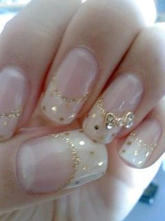For Dani these made me think of you! like the white with gold dots on the whole nail, minus the acrylic and the bow