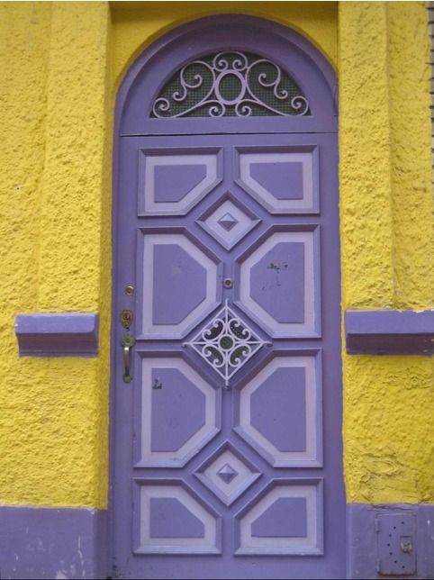A colorful painted door at Candelaria District, in Bogota, Colombia