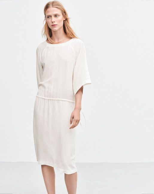 This breezy super-soft dress is styled with an adjustable drawstring tie at the front, elasticated at the back. Subtly flared ¾ raglan sleeve. The relaxed silhouette makes it the perfect work-to-weekend look. Wear yours with heels for a more well-dressed