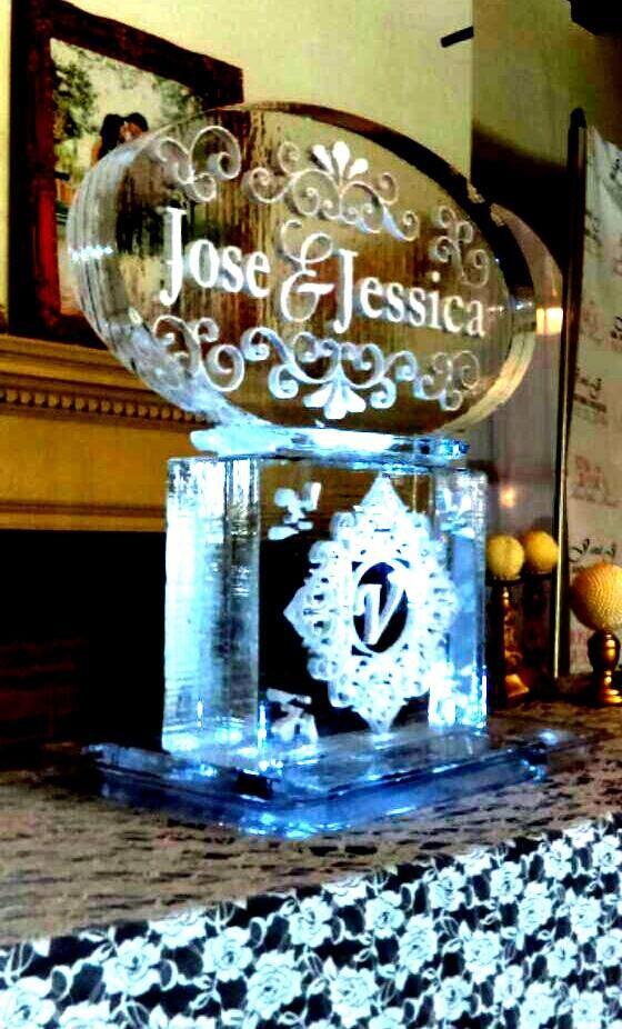 Multi block ice sculpture with a monogram for a wedding reception. #icesculptures #weddingice #weddingdecor
