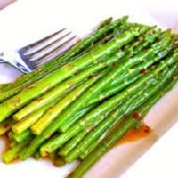 Marinated Asparagus - This versatile recipe made with fresh asparagus can be made year around. Serve it cold or warm as side with any meal.   My favorite way to serve this is grilling it. It produces rave reviews every time. Even from guests who may not be fans of asparagus.