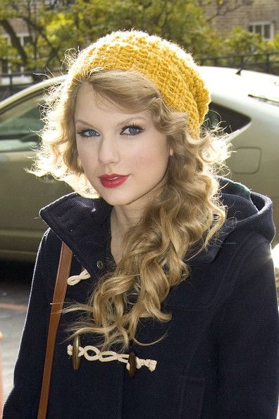Taylor Swift Knit Beanie - Taylor Swift looked as cozy as ever in a sunny knit beanie and navy pea coat.  The country singer got all dolled to promote her new CD at a London TV studio.