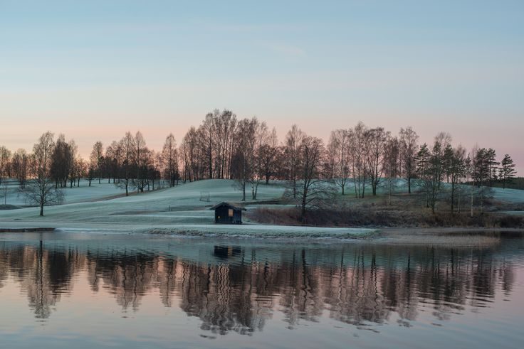 Bogstad golfcourse in the morning, first frost, sun is just about to show up.