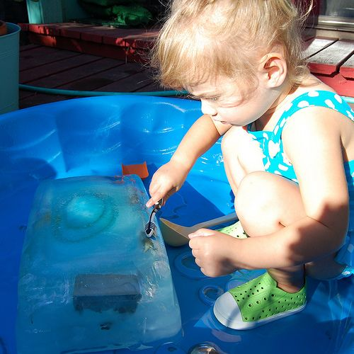 """Excavating dinosaurs from a block of ice!      """"Tallulah spent a good hour or more working on getting her dinosaurs out which in toddler time is like days.""""     Truth."""