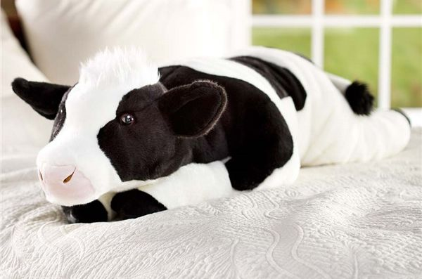 This cuddly cow body pillow is the perfect gift to give for those who love to cozy up in bed.