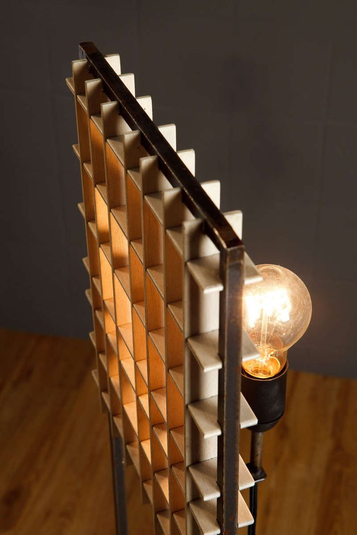 Column floor lamp. The light source is half hidden behind a plywood grid. Optional paint for the metal frame.