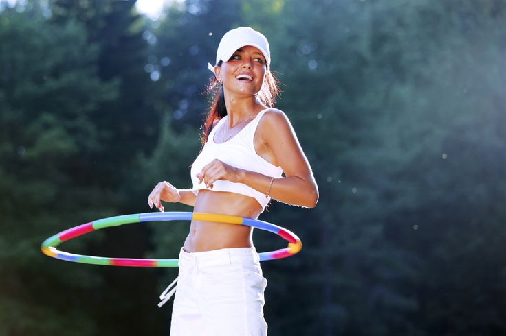 If you want to target and tone your tummy, then have some fun brushing up on your childhood hula-hooping skills!
