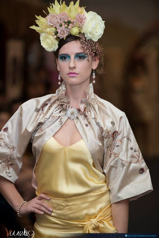 On the MSFW 2013 Art du Jour Runway - Emma wears a stunning embroidered Emily is wearing a bolero and dress by Leiela, jewels from our Andrea Agosta Designer Collection and a gorgeous floriography headpiece of leucadendron, hypericum, roses and andromeda...