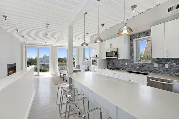 This luxury modern beach home, located on the dunes in Amagansett, New York, was constructed in modular units from repurposed steel shipping containers. Beach Box, which is located about 600 feet from the ocean, was built with EcoTop counters, tankless water heating, a 16 SEER HVAC unit, spray foam insulation, a white thermoplastic roof, Energy Star appliances, FSC-certified cypress siding and decking, and white oak floors.