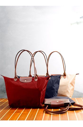 Longchamp bags are one of my favorite brands. The Le Pliage totes fold up for