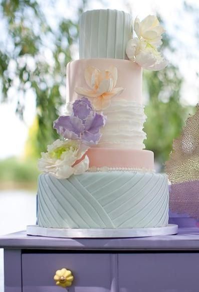 Pastel blue and peach wedding cake...