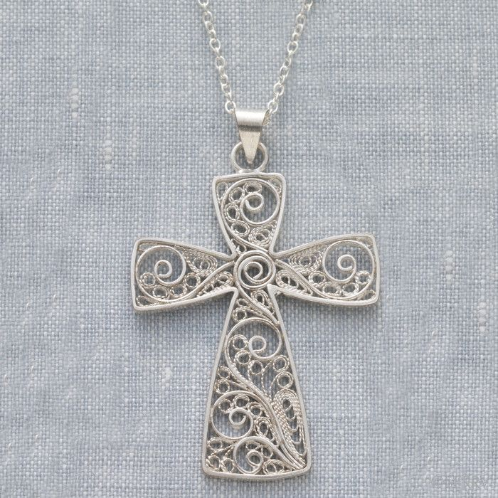 This exquisite filigree pendant has beautiful details throughout and a classic shape. Silver-plated copper pendant on a silver-plated chain. - Handmade in Indonesia - Dimensions: 2 in. long x 1.25 in.