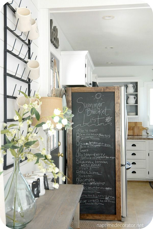 Hide the ugly exposed side of a refrigerator with a chalkboard