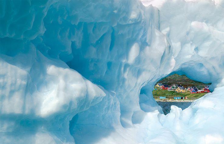 greenland town narsaq through iceberg