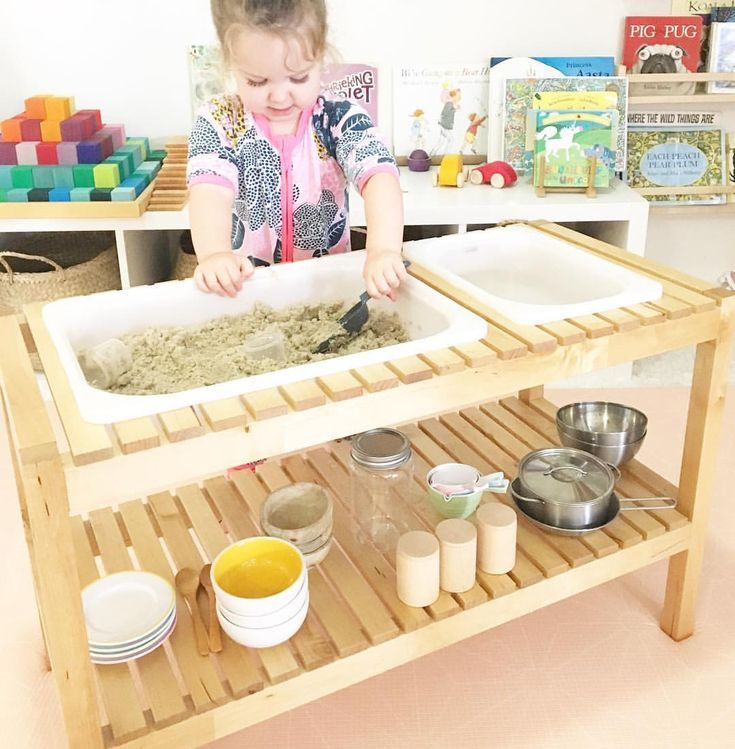 sand and water table made from Ikea bench and tubs