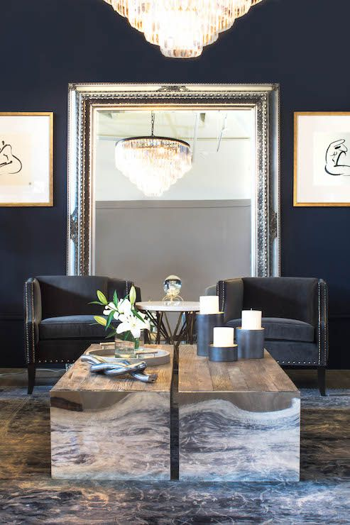 Navy Living Room Features Walls Painted Blue Alongside A Pair Of Accent Chairs With