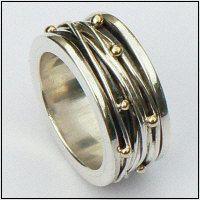 Handgemaakte zilveren ring met goud: Lluvia de oro