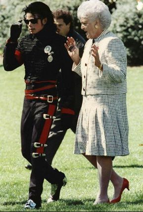 Michael Jackson and Barbara Bush practicing dance steps on the White House Lawn.